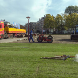 Amsterdam, The Netherlands - October 11, 2018: Professional workers laying new grass rolls in park with special cars and tools
